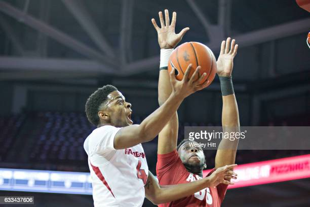 Daryl Macon of the Arkansas Razorbacks goes up for a shot against Donta Hall of the Alabama Crimson Tide at Bud Walton Arena on February 1 2017 in...