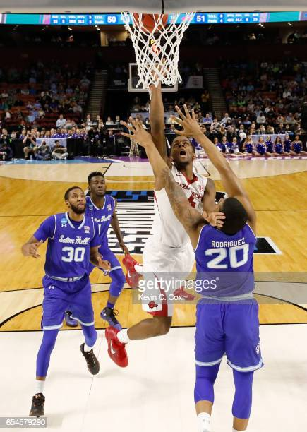 Daryl Macon of the Arkansas Razorbacks goes up for a shot against Desi Rodriguez of the Seton Hall Pirates in the first round of the 2017 NCAA Men's...