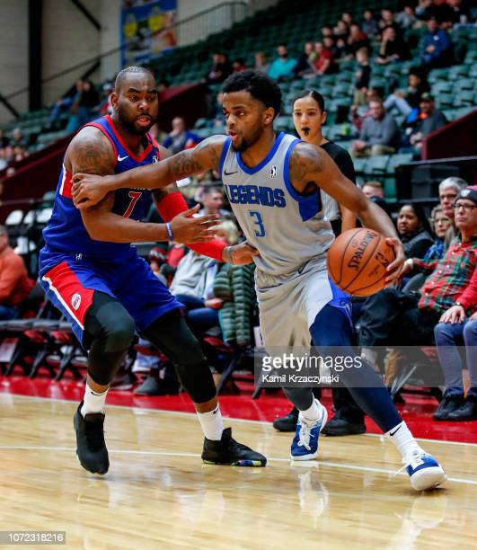 Daryl Macon of the Texas Legends drives to the basket against Marcus Thornton of the Grand Rapids Drive on December 12 2018 at DeltaPlex Arena in...