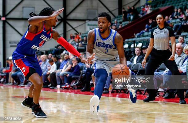 Daryl Macon of the Texas Legends is defended by Speedy Smith of the Grand Rapids Drive on December 12 2018 at DeltaPlex Arena in Grand Rapids...