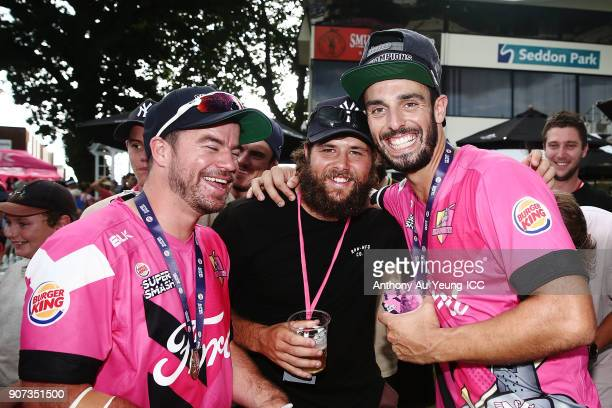 Daryl Mitchell and Peter Bocock of the Knights celebrate with the fans after winning the Super Smash Grand Final match between the Knights and the...