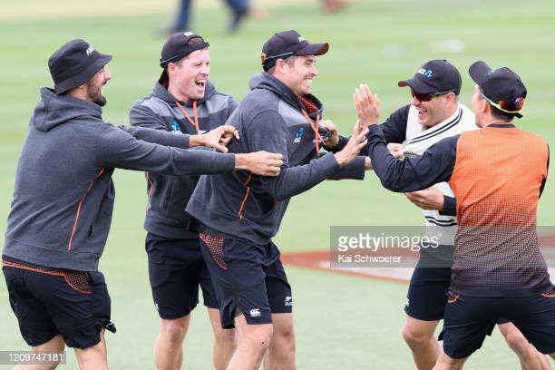 Daryl Mitchell, Henry Nicholls, Tim Southee, Neil Wagner and Trent Boult of New Zealand warm up prior to day three of the Second Test match between...