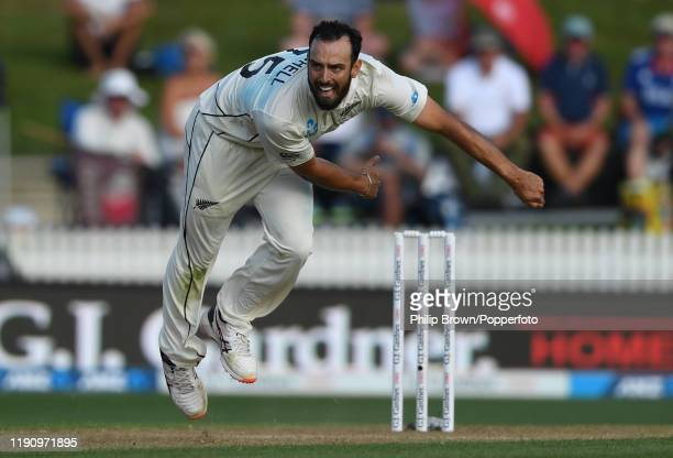 Daryl Mitchell of New Zealand bowls during day 2 of the second Test match between New Zealand and England at Seddon Park on November 30, 2019 in...