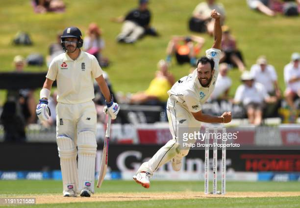 Daryl Mitchell of New Zealand bowls past Rory Burns during day 3 of the second Test match between New Zealand and England at Seddon Park on December...