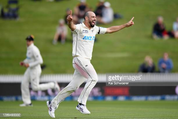 Daryl Mitchell of New Zealand celebrates after dismissing Jason Holder of the West Indies during day three of the First Test match in the series...
