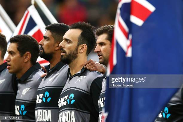 Daryl Mitchell of New Zealand sings the national anthem during game one of the International T20 Series between the New Zealand Black Caps and India...