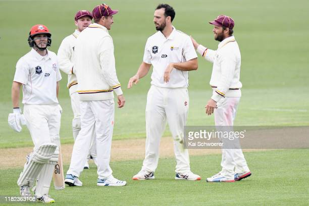 Daryl Mitchell of Northern Districts is congratulated by team mates after dismissing Todd Astle of Canterbury during the Plunket Shield match between...