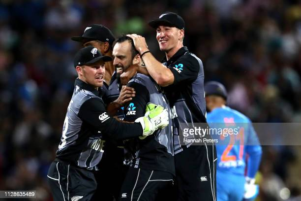 Daryl Mitchell of the Black Caps celebrates the wicket of MS Dhoni of India during the International T20 Game 3 between India and New Zealand at...