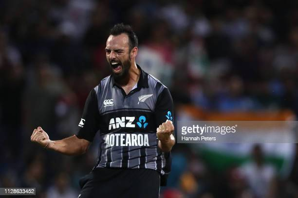 Daryl Mitchell of the Black Caps celebrates the wicket of Rohit Sharma of India during the International T20 Game 3 between India and New Zealand at...