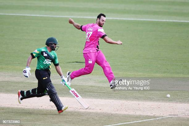 Daryl Mitchell of the Knights kicks the ball towards the stumps as Ajaz Patel of the Stags looks to make his ground during the Super Smash Grand...