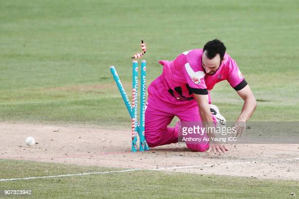 Daryl Mitchell of the Knights stumbles at the stumps trying to run out Ajaz Patel of the Stags during the Super Smash Grand Final match between the...