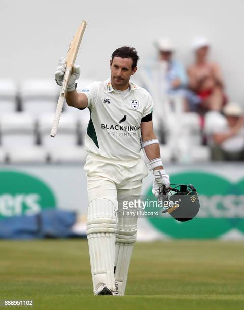 Daryl Mitchell of Worcestershire celebrates his century during the Specsavers County Championship division two match between Northamptonshire and...