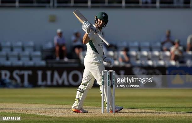 Daryl Mitchell of Worcestershire celebrates his half century during the Specsavers County Championship division two match between Northamptonshire...