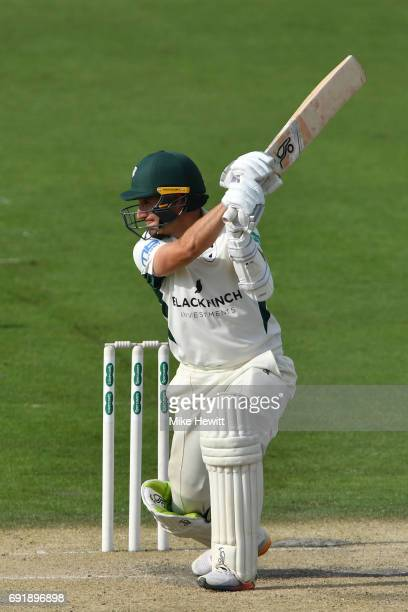 Daryl Mitchell of Worcestershire drives a ball from Vernon Philander to the boundary during the second day of the Specsavers County Championship...