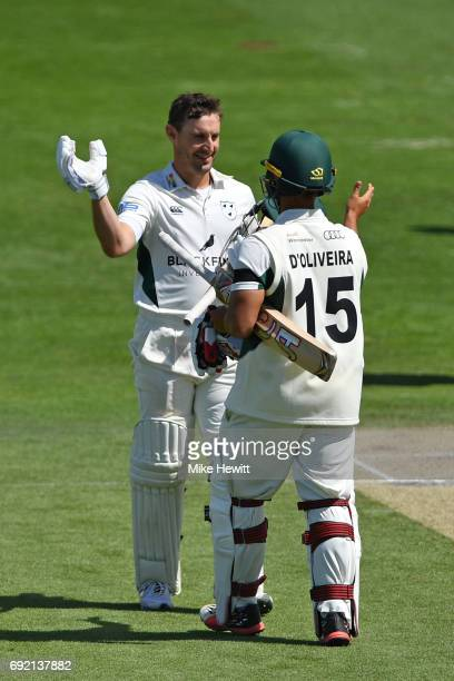 Daryl Mitchell of Worcestershire is congratulated by his opening partner Brett D'Oliveira after reaching his century during the third day of the...