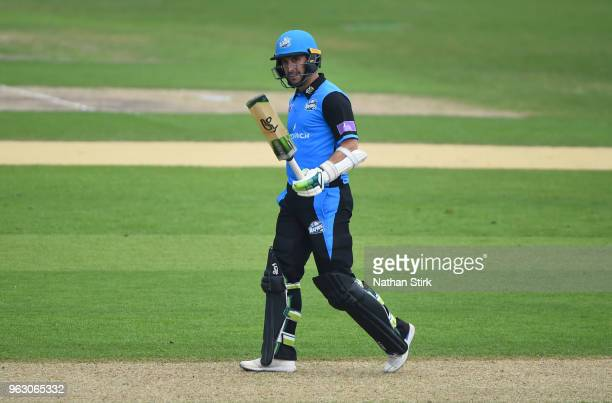 Daryl Mitchell of Worcestershire raises his bat after scoring 100 runs during the Royal London OneDay Cup match between Worcestershire and Lancashire...