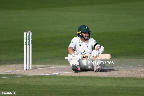 Daryl Mitchell of Worcestershire takes a tumble avoiding a Chris Jordan bouncer during the third day of the Specsavers County Championship Division...