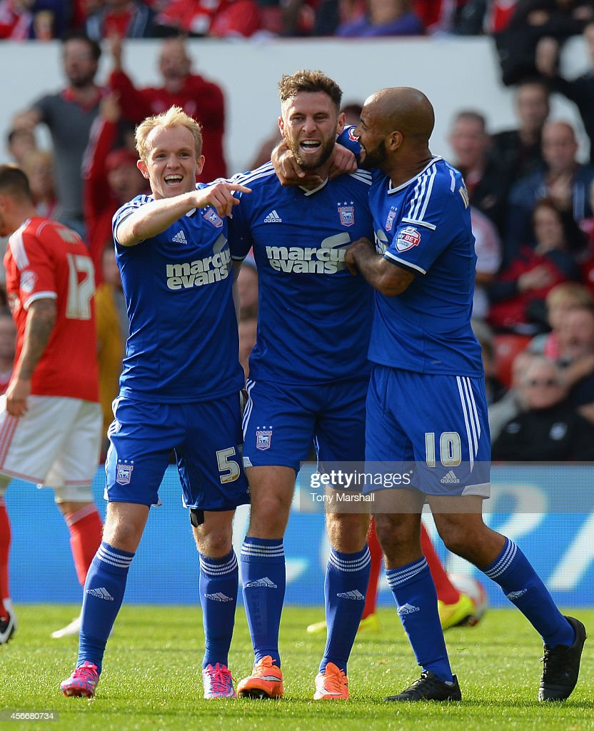 Daryl Murphy of Ipswich Town celebrates scoring their first goal during the Sky Bet Championship match between Nottingham Forest and Ipswich Town at City Ground on October 5, 2014 in Nottingham, England.