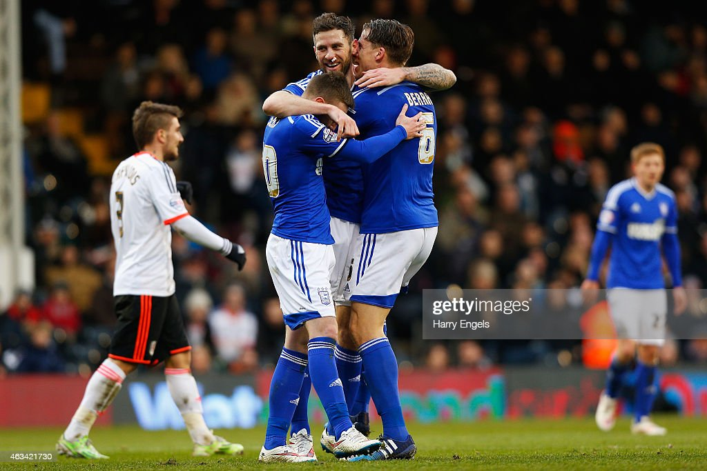 Daryl Murphy of Ipswich Town (C) celebrates with teammates Freddie Sears (L) and Christophe Berra (R) after scoring his second goal during the Sky Bet Championship match between Fulham and Ipswich Town at Craven Cottage on February 14, 2015 in London, England.