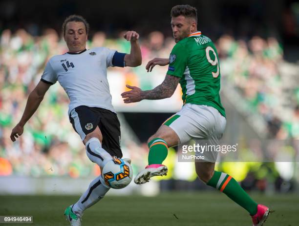 Daryl Murphy of Ireland and Julian Baumgartlinger of Austria fight for the ball during the FIFA World Cup 2018 Qualifying Round Group D match between...