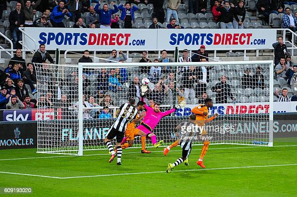 Daryl Murphy of Newcastle United heads the ball over the top of the goal whilst Wolverhampton Wanderers Goalkeeper Andy Longergan dives in attempt to...