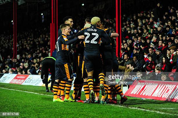 Daryl Murphy of Newcastle United is swamped by teammates after scoring Newcastle's second goal during the Championship Match between Brentford and...