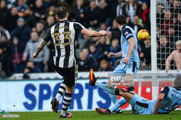 Daryl Murphy of Newcastle United scores the opening goal during the Sky Bet Championship match between Newcastle United and Rotherham United at...