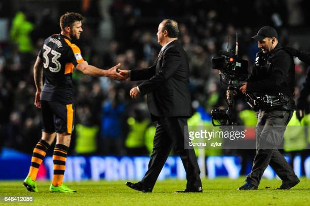 Daryl Murphy of Newcastle United shakes hands with Newcastle Unitedâs Manager Rafael Benitez as Newcastle win the Sky Bet Championship Match between...