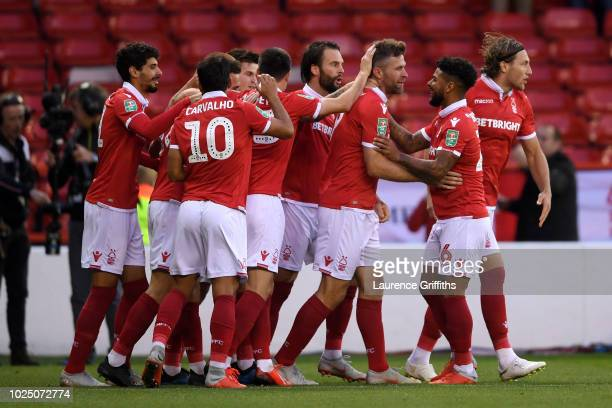 Daryl Murphy of Nottingham Forest celebrates as he scores his team's first goal with team mates during the Carabao Cup Second Round match between...