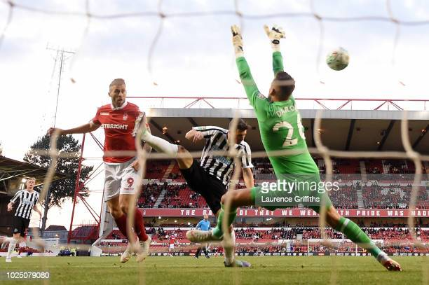 Daryl Murphy of Nottingham Forest scores his team's first goal during the Carabao Cup Second Round match between Nottingham Forest and Newcastle...