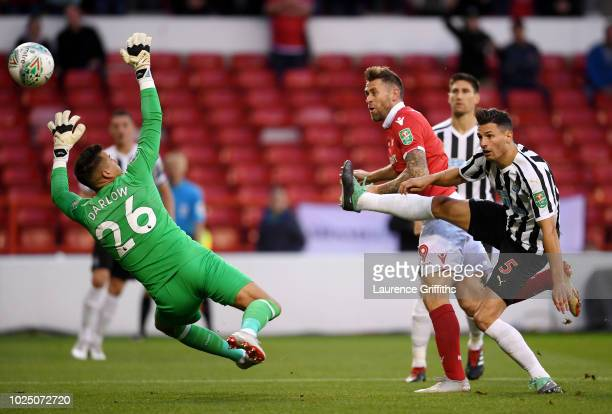 Daryl Murphy of Nottingham Forest scores his team's first goal past Karl Darlow of Newcastle United during the Carabao Cup Second Round match between...