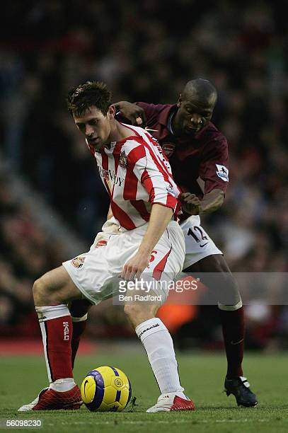 Daryl Murphy of Sunderland is challenged by Lauren of Arsenal during the Barclays Premiership match between Arsenal and Sunderland at Highbury on...