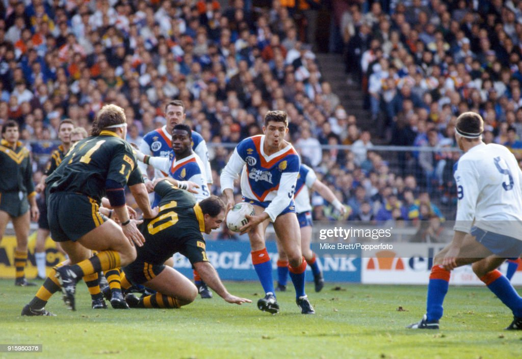 Daryl Powell of Sheffield and Great Britain (with the ball) evades Martin Bell (10) and Paul Sironen (11) of Australia during their International rugby league match at Wembley Stadium in London on 27th October 1990. Great Britain won 19-12.