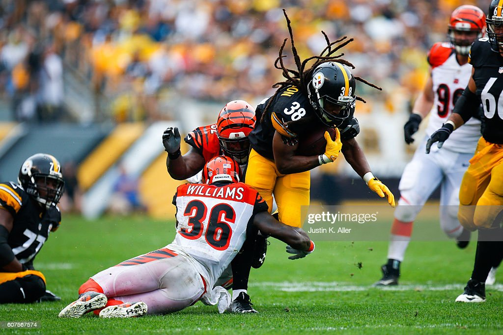 Daryl Richardson #38 of the Pittsburgh Steelers is tackled by Shawn Williams #36 of the Cincinnati Bengals in the first half during the game at Heinz Field on September 18, 2016 in Pittsburgh, Pennsylvania.