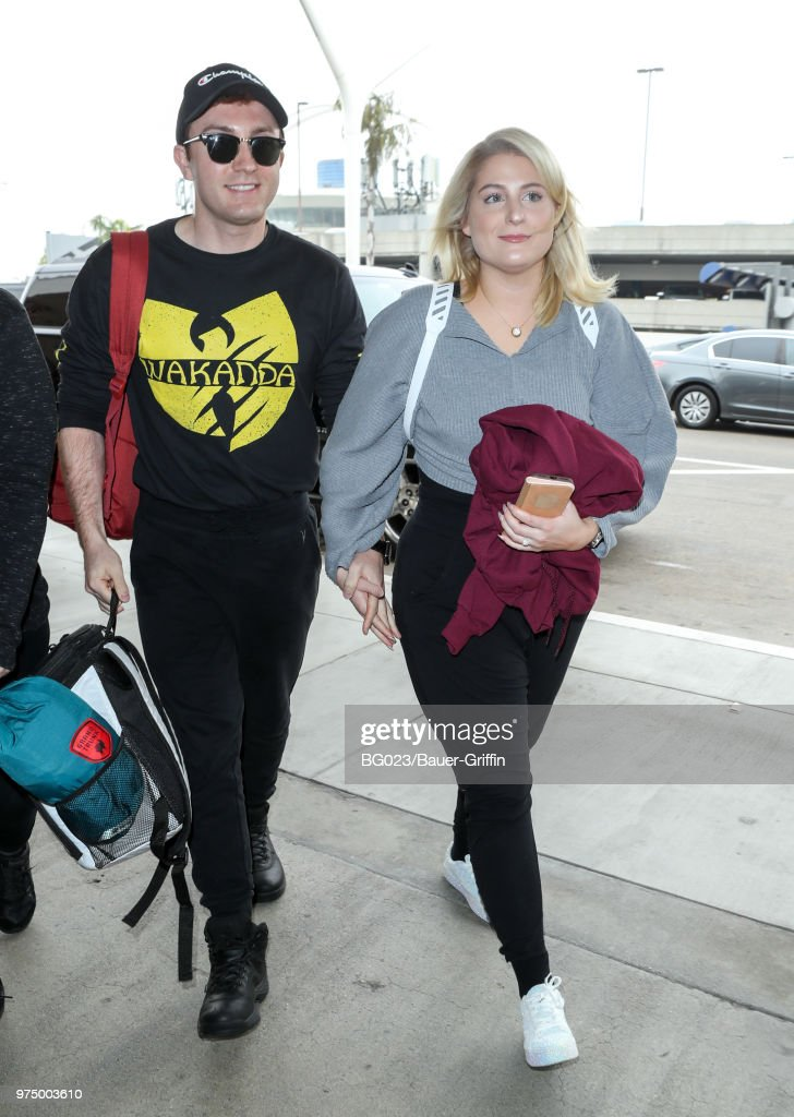 Daryl Sabara and Meghan Trainor are seen at LAX on June 14, 2018 in Los Angeles, California.