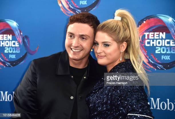 Daryl Sabara and Meghan Trainor attend FOX's Teen Choice Awards at The Forum on August 12 2018 in Inglewood California