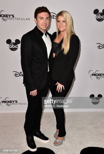 Daryl Sabara and Meghan Trainor attend Mickey's 90th Spectacular at The Shrine Auditorium on October 6 2018 in Los Angeles California