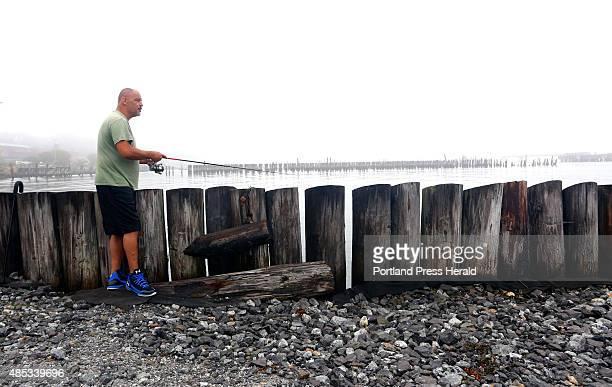 Daryl Sherburne of Portland uses a mackerel jig while fishing near Ocean Gateway in Portland