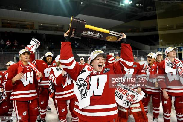 Daryl Watts of the Wisconsin Badgers hoists the NCAA Championship Trophy following the Badgers 2-1 win over the Northeastern Huskies in overtime...