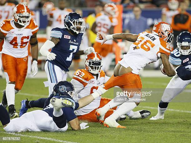 Daryl Waud of the Toronto Argonauts tries to tackle Anthony Allen of the BC Lions by the pants during a CFL game at BMO field on August 31 2016 in...
