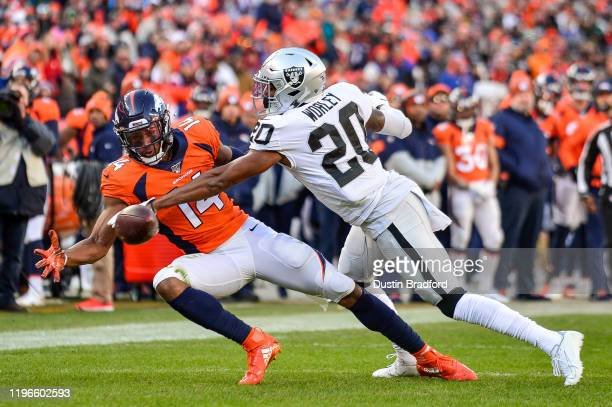 Daryl Worley of the Oakland Raiders breaks up a pass intended for Courtland Sutton of the Denver Broncos and is subsequently flagged for interference...