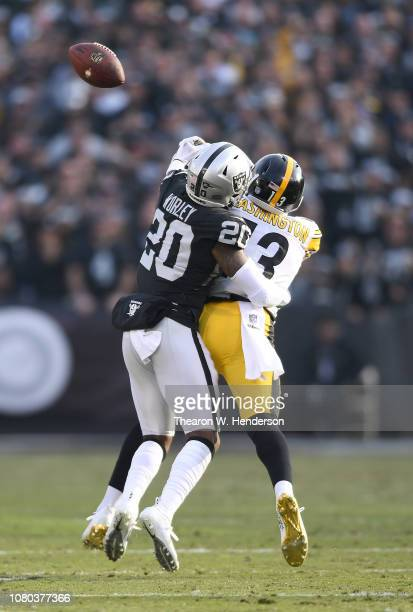 Daryl Worley of the Oakland Raiders breaks up the pass to James Washington of the Pittsburgh Steelers during the second half of an NFL football game...