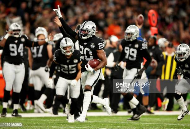 Daryl Worley of the Oakland Raiders runs with the ball after making an interception going on to score a touchdown which is later reversed after a...