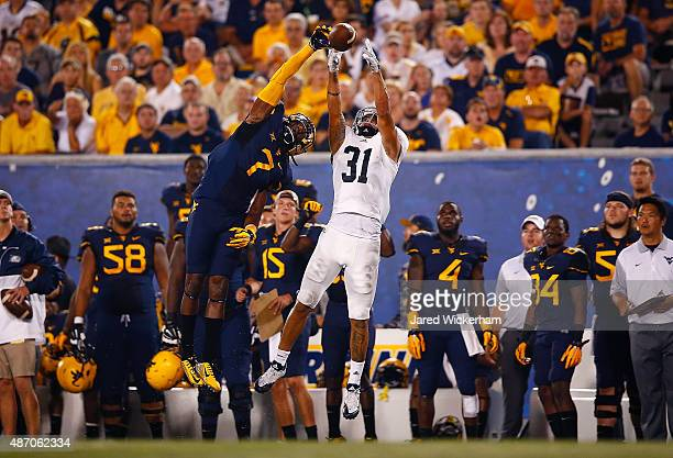 Daryl Worley of the West Virginia Mountaineers breaks up a pass intended for Ryan Longoria of the Georgia Southern Eagles in the first half during...