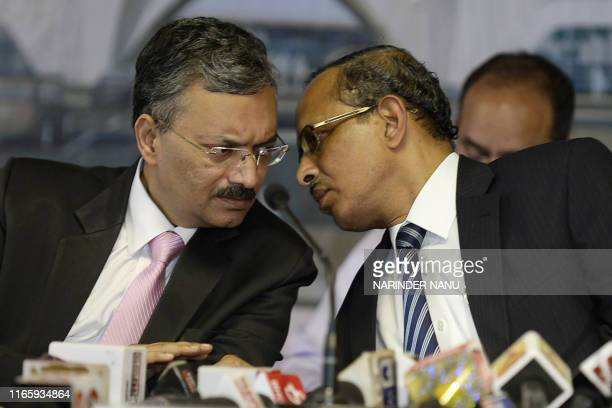 SCL Das joint secretary at the Indian Home Ministry speaks with Foreign Ministry joint secretary Deepak Mittal at a press conference after attending...