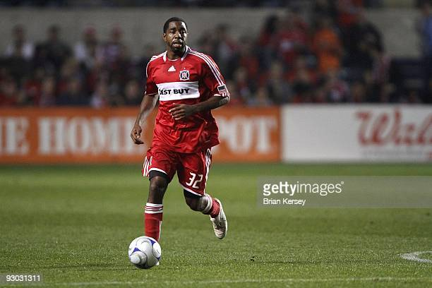 Dasan Robinson of the Chicago Fire moves the ball up the field against the New England Revolution during the second half of game 2 of the Eastern...