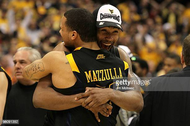 Da'Sean Butler and Joe Mazzulla of the West Virginia Mountaineers celebrate after they won 73-66 against the Kentucky Wildcats during the east...