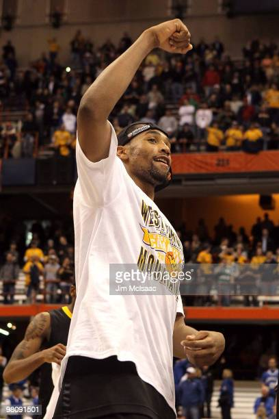 Da'Sean Butler of the West Virginia Mountaineers celebrates after West Virginia won 7366 against the Kentucky Wildcats during the east regional final...