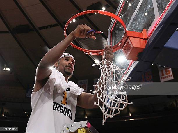 Da'Sean Butler of the West Virginia Mountaineers cuts down the net after defeating the Georgetown Hoyas in the championship of the 2010 NCAA Big East...
