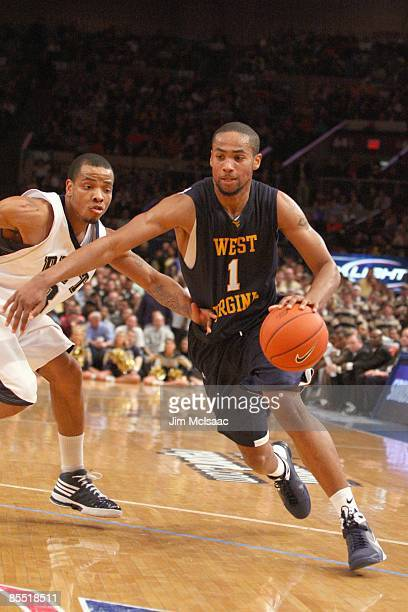 Da'Sean Butler of the West Virginia Mountaineers drives the ball against the Pittsburgh Panthers during the second round of the Big East Tournament...